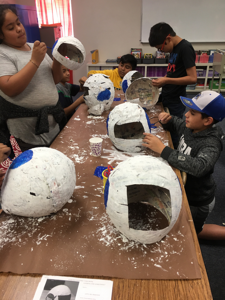 Grade 4 and 5 Students Making Space Helmets