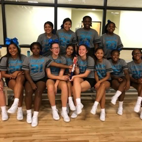 Varsity Cheerleaders with Spirit Stick